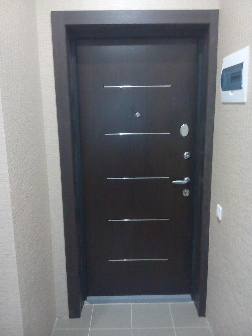 Как обложить входную дверь кирпичом